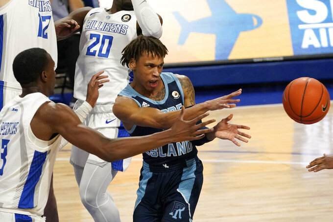 Rhode Island's Fatts Russell, right, passes as Saint Louis' Javonte Perkins (3) defends during the first half of an NCAA college basketball game Wednesday, Feb. 10, 2021, in St. Louis. (AP Photo/Jeff Roberson)