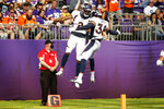 Denver Broncos cornerback Pat Surtain II (2) celebrates with teammate Saivion Smith (38) after returning an interception 30-yards for a touchdown during the first half of an NFL preseason football game against the Minnesota Vikings, Saturday, Aug. 14, 2021, in Minneapolis. (AP Photo/Bruce Kluckhohn)