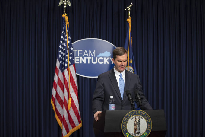 Kentucky Gov. Andy Beshear provides an update on the COVID-19 pandemic in the state during a media conference at the Kentucky state Capitol in Frankfort, Ky., on Thursday, Jan. 21, 2021. (Ryan C. Hermens/Lexington Herald-Leader via AP)