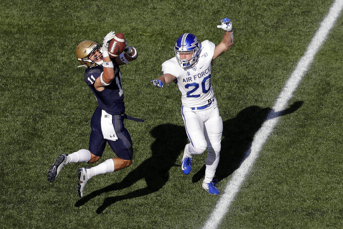 Navy safety Evan Fochtman, left, intercepts a pass intended for Air Force wide receiver Benjamin Waters, right, during the first half of an NCAA college football game Saturday, Oct. 5, 2019, in Annapolis, Md. (AP Photo/Julio Cortez)