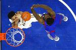 Villanova's Jeremiah Robinson-Earl, left, goes up for a shot against Kansas' Udoka Azubuike during the second half of an NCAA college basketball game, Saturday, Dec. 21, 2019, in Philadelphia. (AP Photo/Matt Slocum)