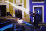 Police units launch tear gas to control several riots near the executive mansion while demonstrators demand the resignation of Gov. Ricardo Rossello in San Juan, Puerto Rico, Monday, July 22, 2019. Protesters are demanding Gov. Ricardo Rossello step down following the leak of an offensive, obscenity-laden online chat between him and his advisers that triggered the crisis.  (AP Photo/Carlos Giusti)