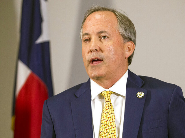 FILE - In this May 1, 2018, file photo, Texas Attorney General Ken Paxton speaks at a news conference in Austin, Texas. The state of Texas has filed suit against a Houston auctioneer, accusing him of price-gouging in his auctioning of 750,000 medical-grade and N95 face masks, Paxton's office announced Thursday, March 26, 2020. (Nick Wagner/Austin American-Statesman via AP, File)