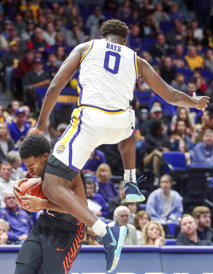 Bowling Green guard Justin Turner (1) is fouled by LSU forward Darius Days (0) in the first half of an NCAA college basketball game in Baton Rouge, La., Friday, Nov. 8, 2019. (AP Photo/Brett Duke)