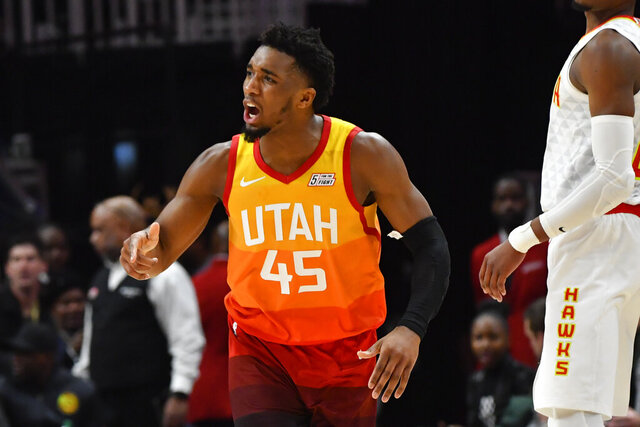 Utah Jazz guard Donovan Mitchell (45) reacts after sinking a three-point basket during the second half of an NBA basketball game against the Atlanta Hawks, Thursday, Dec. 19, 2019, in Atlanta. (AP Photo/John Amis)