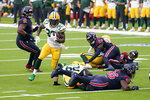Green Bay Packers running back Jamaal Williams (30) runs with the ball during the second half of an NFL football game against the Houston Texans Sunday, Oct. 25, 2020, in Houston. (AP Photo/Sam Craft)