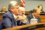 House Republican leader Lance Harris, R-Alexandria, left, asks questions about an estimated $500 million surplus during a meeting of the House and Senate budget committee on Friday, Sept. 13, 2019, in Baton Rouge, La. (AP Photo/Melinda Deslatte)