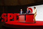 German Finance Minister Olaf Scholz, center, and the Social Democratic Party leaders Saskia Esken, right, und Norbert Walter-Borjans, left, attend a news conference in Berlin, Germany, Monday, Aug. 10, 2020. The SPD announced that Olaf Scholz will run for the party as chancellor candidate at next year's general elections in Germany. (AP Photo/Markus Schreiber)
