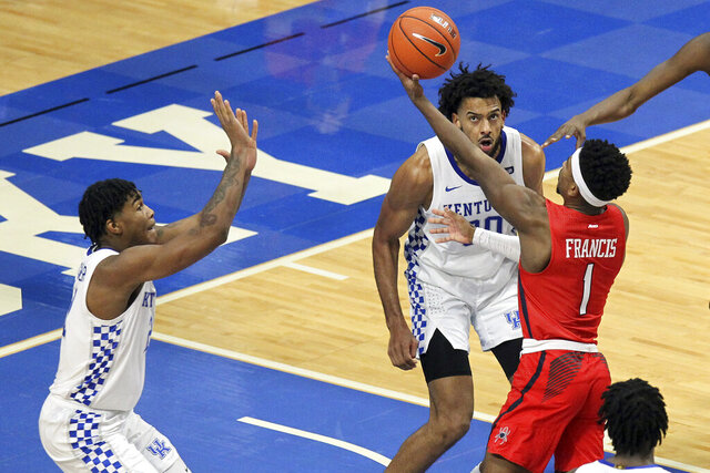 Richmond's Blake Francis (1) shoots near Kentucky's Cam'Ron Fletcher, left, and Olivier Sarr during the second half of an NCAA college basketball game in Lexington, Ky., Sunday, Nov. 29, 2020. (AP Photo/James Crisp)