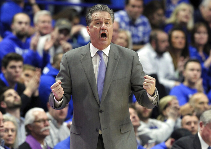 Kentucky coach John Calipari yells to his team during the second half of an NCAA college basketball game against Tennessee in Lexington, Ky., Saturday, Feb. 16, 2019. Kentucky won 86-69. (AP Photo/James Crisp)