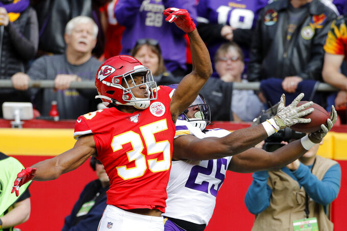 Minnesota Vikings running back Alexander Mattison (25) makes a catch against the defense of Kansas City Chiefs cornerback Charvarius Ward (35), during the first half of an NFL football game in Kansas City, Mo., Sunday, Nov. 3, 2019. (AP Photo/Colin E. Braley)
