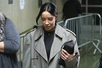 Mexican model Claudia Salinas leaves court after testifying in Harvey Weinstein's rape trial, Monday, Feb. 10, 2020 in New York. The Mexican model and actress denies a Harvey Weinstein accuser's claim that she stood by and did nothing while the once-powerful movie mogul groped the woman in a Beverly Hills hotel in 2013. (AP Photo/Mark Lennihan)