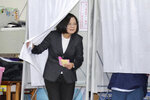 Taiwanese President and presidential election candidate Tsai Ing-wen emerges from a voting booth at a polling station in New Taipei City, Taiwan, Saturday, Jan. 11, 2020. The future of Taiwan's democracy is on the line as the self-ruled island's 19 million voters decide on whether to give independence-leaning President Tsai Ing-wen a second term.(Chang Hao-an/Pool Photo via AP)