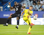 CF Montreal's Kamal Miller (3) defends against Nashville SC's Daniel Rios during the first half of an MLS soccer match Saturday, Sept. 11, 2021, in Montreal. (Graham Hughes/The Canadian Press via AP)