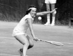 FILE - In this Sept. 3, 1977, file photo, Rosemary Casals, of Sausalito, Calif. goes for the ball on her way to her second-round win in the U.S. Open tennis championships in the Forest Hills neighborhood of the Queens borough of New York. Casals and eight other women risked their tennis careers 50 years ago when they signed $1 contracts to launch a new women's circuit. (AP Photo/Dave Pickoff)