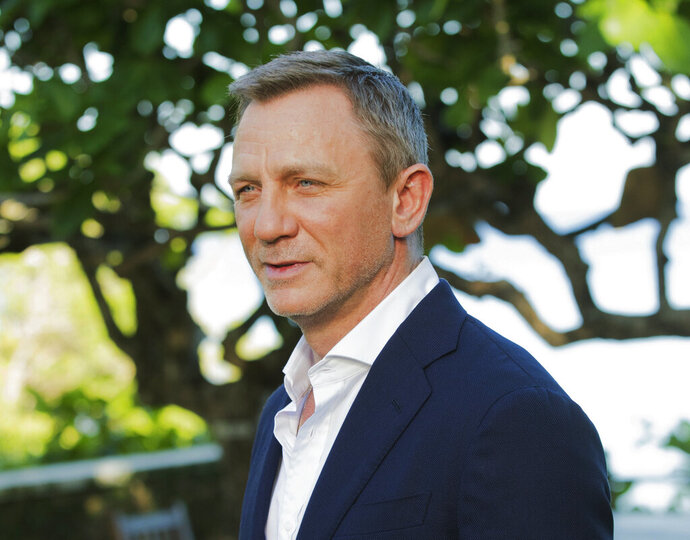 FILE - In this April 25, 2019, file photo, actor Daniel Craig poses for photographers during the photo call of the latest installment of the James Bond film franchise, currently known as