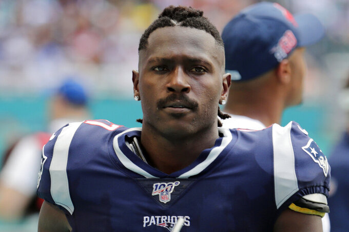 FILE - In this Sept. 15, 2019, file photo, New England Patriots wide receiver Antonio Brown (17) watches on the sidelines during the first half at an NFL football game against the Miami Dolphins in Miami Gardens, Fla. The NFL has suspended Brown for the first eight regular-season games of the 2020 season Friday, July 31, 2020, under the league's personal conduct policy. Brown does not have a contract with any team. (AP Photo/Lynne Sladky, File)