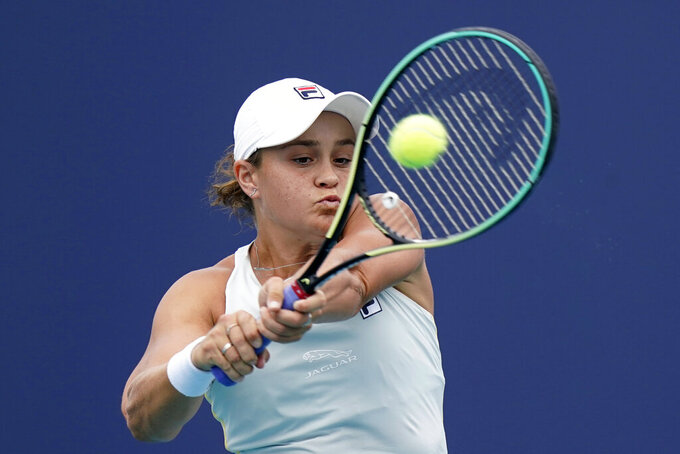 Ashleigh Barty of Australia returns to Bianca Andreescu of Canada during the finals at the Miami Open tennis tournament, Saturday, April 3, 2021, in Miami Gardens, Fla. Barty won 6-3, 4-0, as Andreescu retired due to injury. (AP Photo/Lynne Sladky)