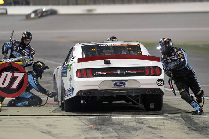 Chase Briscoe (98) pits during a NASCAR Xfinity Series auto race at Kansas Speedway in Kansas City, Kan., Saturday, Oct. 17, 2020. (AP Photo/Orlin Wagner)