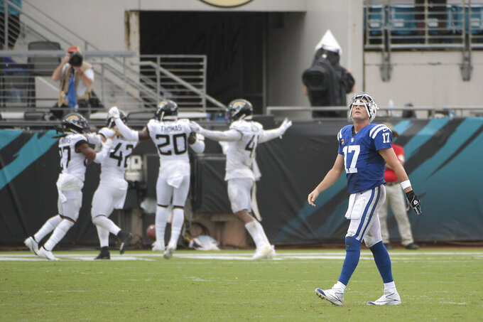 Indianapolis Colts quarterback Philip Rivers (17) walks off the field after the Jacksonville Jaguars intercepted a pass he threw during the second half of an NFL football game, Sunday, Sept. 13, 2020, in Jacksonville, Fla. (AP Photo/Phelan M. Ebenhack)