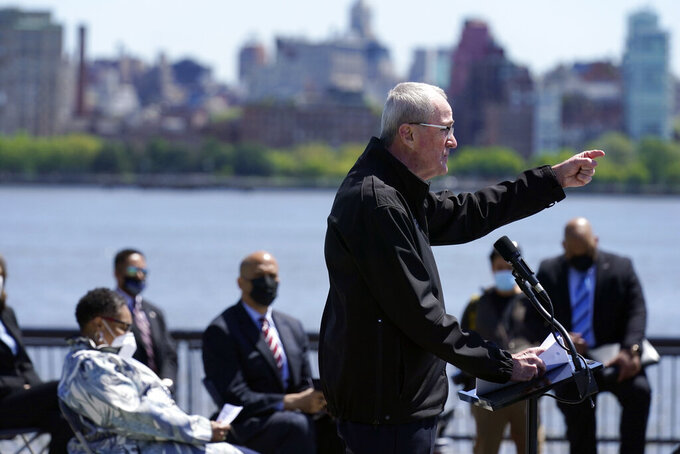 New Jersey Gov. Phil Murphy speaks during a news conference in Hoboken, N.J., Thursday, May 6, 2021. More than eight years after Superstorm Sandy overwhelmed the New York City area, Hoboken is breaking ground on a flood resiliency project that is part of a $230 million plan funded by the U.S. Department of Housing and Urban Development. (AP Photo/Seth Wenig)