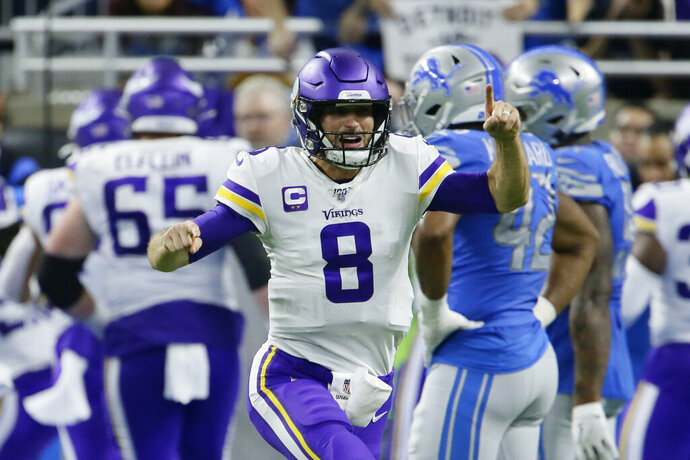 Minnesota Vikings quarterback Kirk Cousins (8) reacts after a touchdown by running back Dalvin Cook during the second half of an NFL football game against the Detroit Lions, Sunday, Oct. 20, 2019, in Detroit. (AP Photo/Duane Burleson)