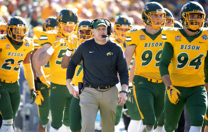 North Dakota State head coach Chris Klieman walks onto the field during a timeout in the first half of the FCS championship NCAA college football game against Eastern Washington, Saturday, Jan. 5, 2019, in Frisco, Texas. The 38-24 win was Klieman's last game at North Dakota State before he takes over as head coach at Kansas State. (AP Photo/Jeffrey McWhorter)