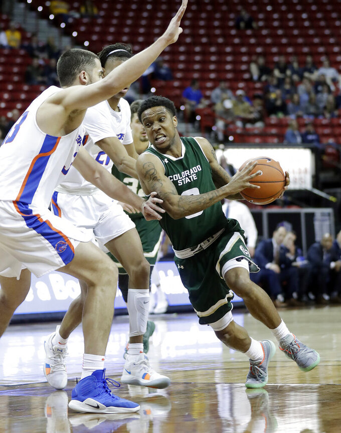 Colorado State's Hyron Edwards, right, drives against Boise State during the second half of an NCAA college basketball game in the Mountain West Conference tournament Wednesday, March 13, 2019, in Las Vegas. (AP Photo/Isaac Brekken)