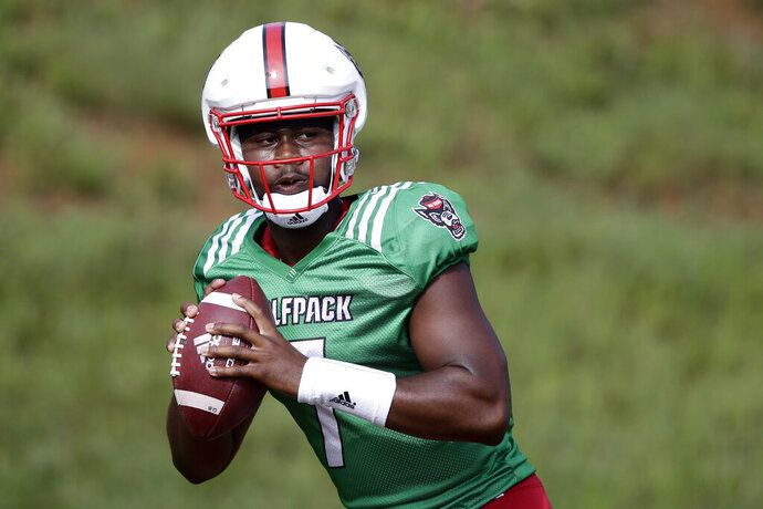 FILE - In this Aug. 6, 2019, file photo, North Carolina State quarterback Matthew McKay is shown during an NCAA college football practice in Raleigh, N.C. McKay will start the season at quarterback for North Carolina State. The redshirt sophomore was listed atop the depth chart released Monday, Aug. 26, 2019, for the Wolfpack's opener against East Carolina.(AP Photo/Gerry Broome, File)