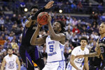 North Carolina's Nassir Little (5) shoots against Washington's Matisse Thybulle, left, during the second half during a second-round men's college basketball game in the NCAA Tournament, Sunday, March 24, 2019, in Columbus, Ohio. (AP Photo/John Minchillo)