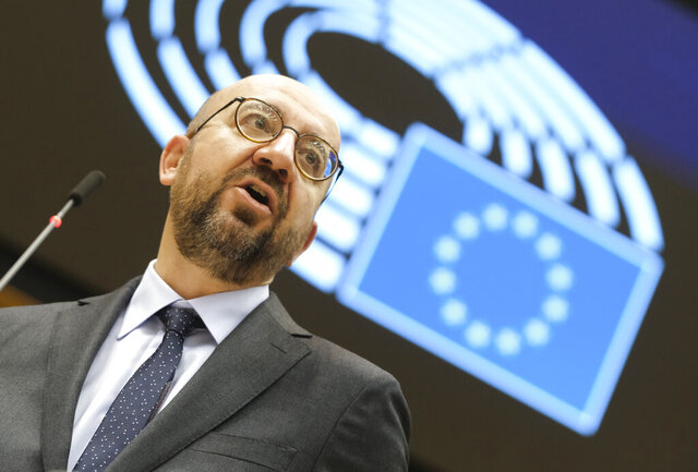 European Council President Charles Michel addresses the chamber on a report of last weeks EU summit during a plenary session at the European Parliament in Brussels, Wednesday, Oct. 21, 2020. (Olivier Hoslet, Pool via AP)