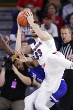 Gonzaga forward Killian Tillie, right, right grabs a rebound over Texas-Arlington forward TiAndre Jackson-Young during the first half of an NCAA college basketball game in Spokane, Wash., Tuesday, Nov. 19, 2019. (AP Photo/Young Kwak)
