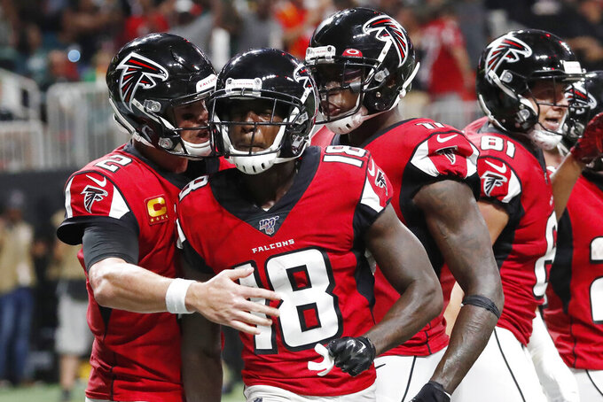 Atlanta Falcons quarterback Matt Ryan (2) celebrates a touchdown pass to Atlanta Falcons wide receiver Calvin Ridley (18) against the Philadelphia Eagles during the first half of an NFL football game, Sunday, Sept. 15, 2019, in Atlanta. (AP Photo/John Bazemore)