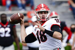 FILE - In this April 17, 2021, file photo, Georgia quarterback JT Daniels (18) throws a pass during their spring NCAA college football spring game in Athens, Ga.. (AP Photo/John Bazemore, File)