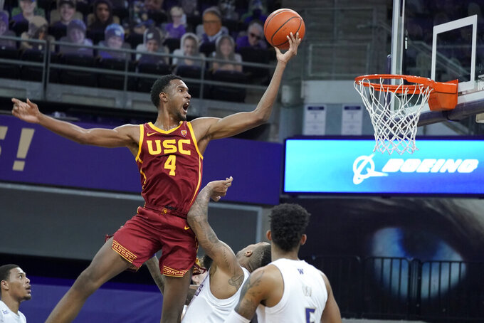 Southern California forward Evan Mobley (4) shoots against Washington during the second half of an NCAA college basketball game, Thursday, Feb. 11, 2021, in Seattle. (AP Photo/Ted S. Warren)