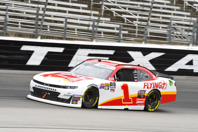 Driver Michael Annett races down front the front stretch during a NASCAR auto race at Texas Motor Speedway, Saturday, March 30, 2019, in Fort Worth, Texas. (AP Photo/Larry Papke)