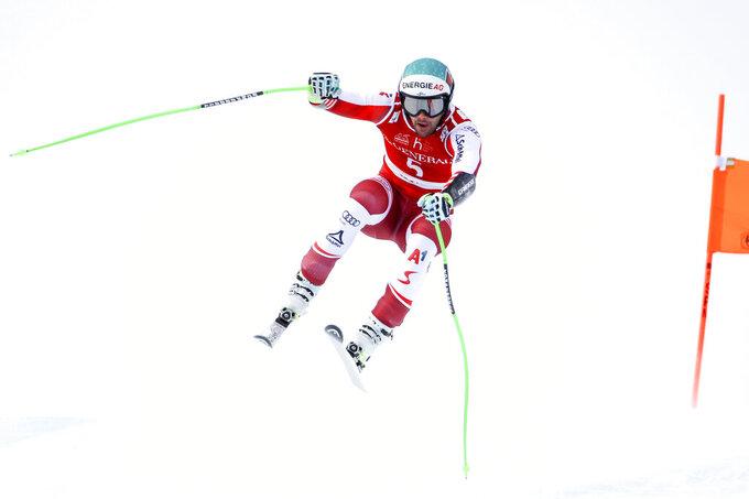 Austria's Vincent Kriechmayr speeds down the course during an alpine ski, men's World Cup Super-G, in Kitzbuehel, Austria, Monday, Jan. 25, 2021. (AP Photo/Marco Trovati)