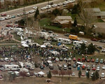 FILE - This April 21, 1999, file photo, shows the news media compound near Columbine High School in Littleton, Colo. Twelve students and one teacher were killed in a murderous rampage at the school on April 20, 1999, by two students who killed themselves in the aftermath. (AP Photo/Ed Andrieski, File)