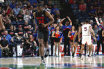 In this Jan. 18, 2020, photo provided by the University of Florida Athletic Association, Florida's Chris Sutherland (34) plays against Auburn during an NCAA college basketball game in Gainesville, Fla. Sutherland waited nearly five years to finally play college basketball. He worked his way onto Florida's bench in January after serving as an arena worker, a practice player for the women's team and a team manager for the men's program. Gaining NCAA eligibility was a daunting task that required him to repay a $5,000 scholarship and remove his name and likeness off a website he created last year to sell streetwear he designed. (Courtney Culbreath/UAA Communications via AP)