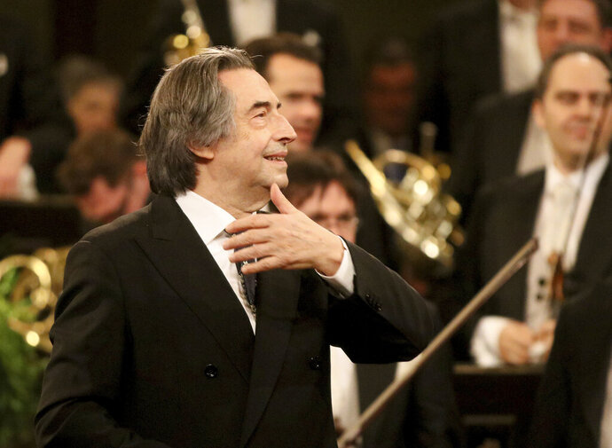 FILE - In this Jan. 1, 2018 file photo, Italian Maestro Riccardo Muti conducts the Vienna Philharmonic Orchestra during the traditional New Year's concert at the golden hall of Vienna's Musikverein, Austria. Riccardo Muti will conduct a youth orchestra in an open-air concert launching the annual Ravenna Festival next month in what organizers billed Friday May 22, 2020, as Italy's first live classical music performance since its strict lockdown to stop the spread of coronavirus. (AP Photo/Ronald Zak, File)