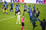 England's Bukayo Saka reacts after missing his shot at goal as Italy celebrate during a penalty shootout at the Euro 2020 soccer championship final between England and Italy at Wembley stadium in London, Sunday, July 11, 2021. (John Sibley/Pool Photo via AP)