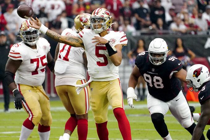 San Francisco 49ers quarterback Trey Lance (5) throws against the Arizona Cardinals during the first half of an NFL football game, Sunday, Oct. 10, 2021, in Glendale, Ariz. (AP Photo/Matt York)