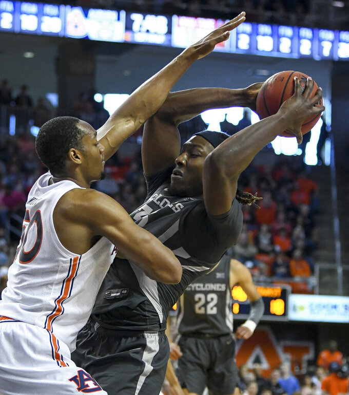 Auburn center Austin Wiley (50) stops a shot by Iowa State forward Solomon Young (33) during the first half of an NCAA college basketball game Saturday, Jan. 25, 2020, in Auburn, Ala. (AP Photo/Julie Bennett)