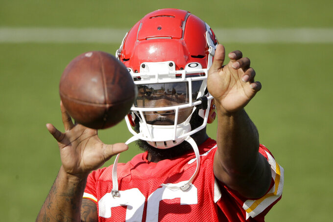 Kansas City Chiefs running back Damien Williams catches a ball during NFL football training camp Saturday, July 27, 2019, in St. Joseph, Mo. (AP Photo/Charlie Riedel)