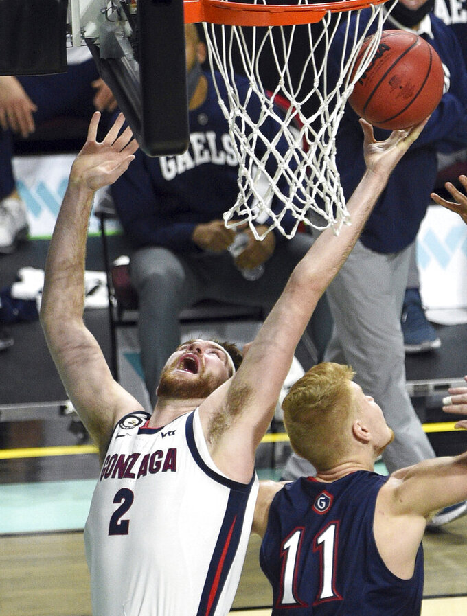 Gonzaga forward Drew Timme (2) rebounds the ball against Saint Mary's during the first half of an NCAA semifinal college basketball game at the West Coast Conference tournament Monday, March 8, 2021, in Las Vegas. (AP Photo/David Becker)