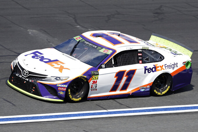 Denny Hamlin drives through Turn 4 during the NASCAR Cup Series auto race at Charlotte Motor Speedway in Concord, N.C., Sunday, Sept. 29, 2019. (AP Photo/Gerry Broome)
