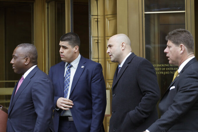 Craig Carton, the former co-host of a sports radio show with ex-NFL quarterback Boomer Esiason, leaves federal court after receiving a 3 1/2 year sentence for defrauding investors in a ticket reselling business, Friday, April 5, 2019, in New York. (AP Photo/Mark Lennihan)