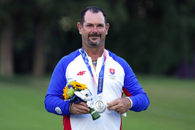Silver medal winner Rory Sabbatini, of Slovakia, stands on the podium after the men's golf event at the 2020 Summer Olympics, Sunday, Aug. 1, 2021, at the Kasumigaseki Country Club in Kawagoe, Japan, (AP Photo/Andy Wong)