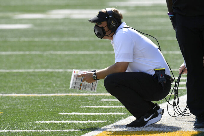 Missouri head coach Eliah Drinkwitz watches from the sidelines during the second half of an NCAA college football game against LSU Saturday, Oct. 10, 2020, in Columbia, Mo. (AP Photo/L.G. Patterson)