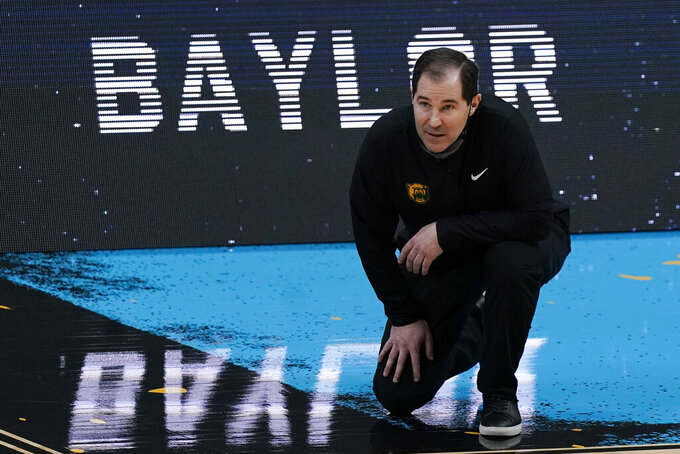 Baylor head coach Scott Drew watches from the sideline during the second half of a men's Final Four NCAA college basketball tournament semifinal game against Houston, Saturday, April 3, 2021, at Lucas Oil Stadium in Indianapolis. (AP Photo/Michael Conroy)
